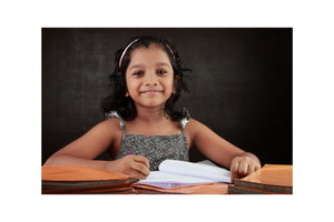 young girl in classroom smiling