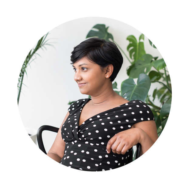 profile picture of Shelly the founder sitting in a chair with black and white polkadot dress