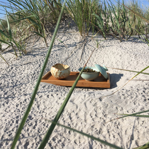 Gaiwan tea session dunes beach sand