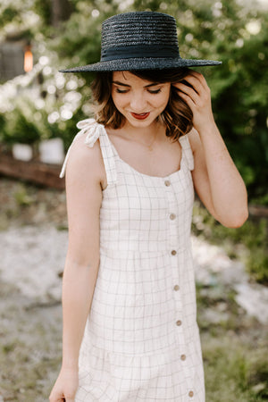 cream_and_black_button_up_dress