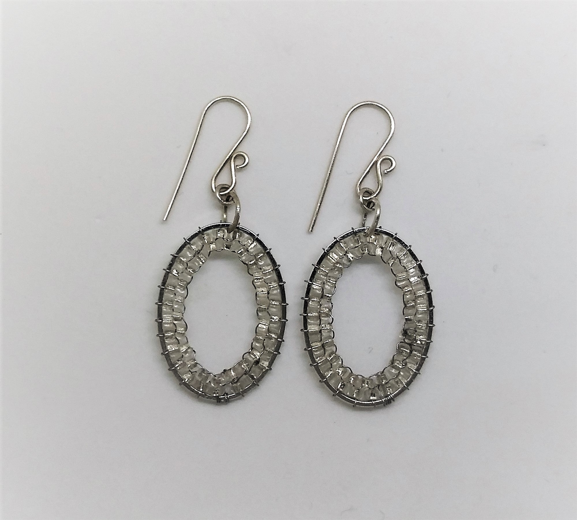Clear Silver Oval Gleam Earrings