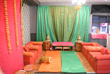 Orange and pink low seating for sangeet