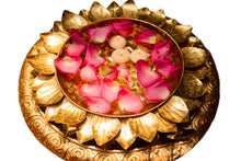 Lotus urli with rosepetals and candles