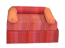 Orange and pink low seating with arm cushions
