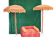 Velvet Green Backdrop with umbrellas and orange seating