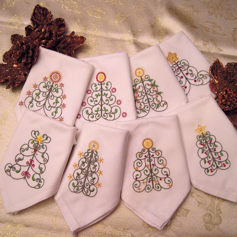 Picture of embroidered Christmas trees on napkins