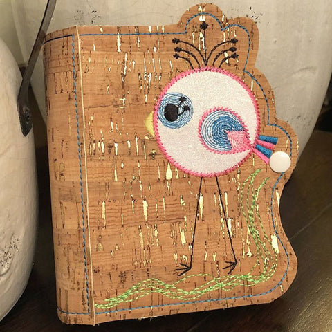 A picture of a in-the-hoop notebook cover with a bird by Sew Inspired by Bonnie.
