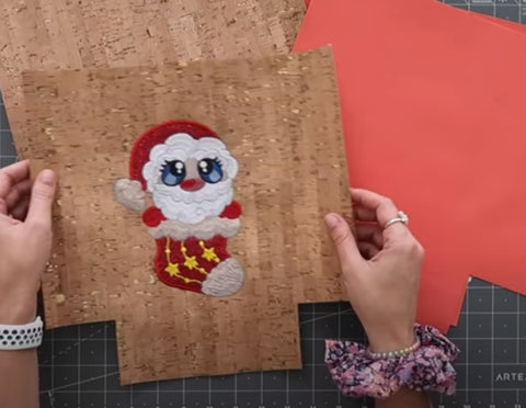 Picture of Santa on front of bag with boxed corners trimmed out.
