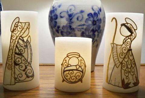 This is a picture of embroidery on candles using a Nativity set of machine embroidery designs.