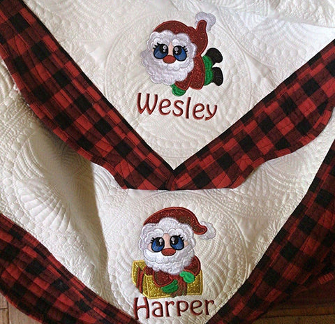 Picture of machine appliqued Santa on quilt.
