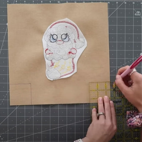This is a picture demonstrating how to mark boxed corners on a treat bag.