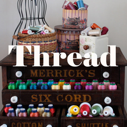 This is a picture of a thread cabinet with lots of different thread types for sewing and machine embroidery.