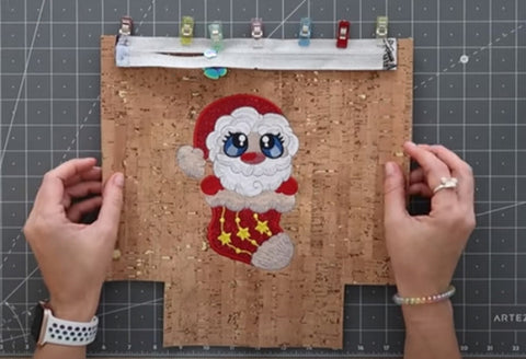 Picture of waterproof zip bag being constructed with a Santa machine applique on front.