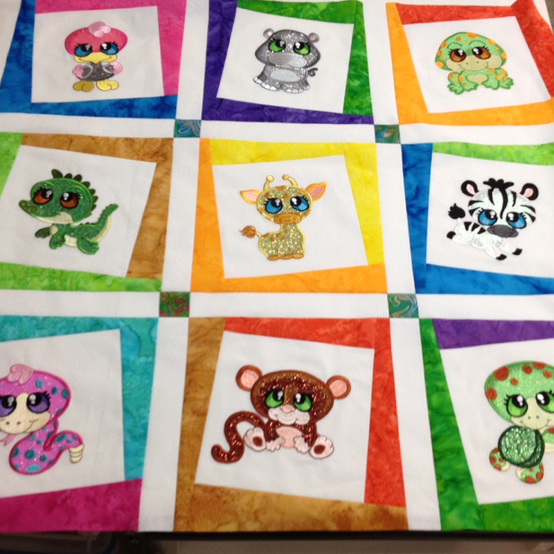 Picture of Jungle Buddies machine applique designs using GlitterFlex at Sew Inspired by Bonnie