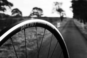 <h1>Spokes</h1><i>We chose the top-of-the-range Pillar Spoke Re-enforcement PSR XTRA models. These butted blade spokes are lighter but also provide a greater degree of elasticity and thus maintain spoke tensions longer and are more fatigue resistant. PSR spokes feature the wider 2.2 width at the spoke head providing more material in this high stress area. J-bend made sense for four season use as replacements are easy to find. The nipples are brass, which is strong and corrosion resistant.</i>