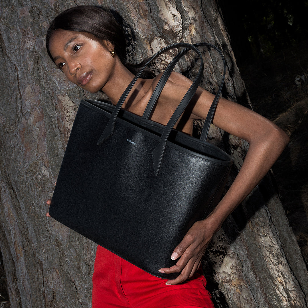 NOUR ZERO The Everything Tote on Model with Red Pants in Forest