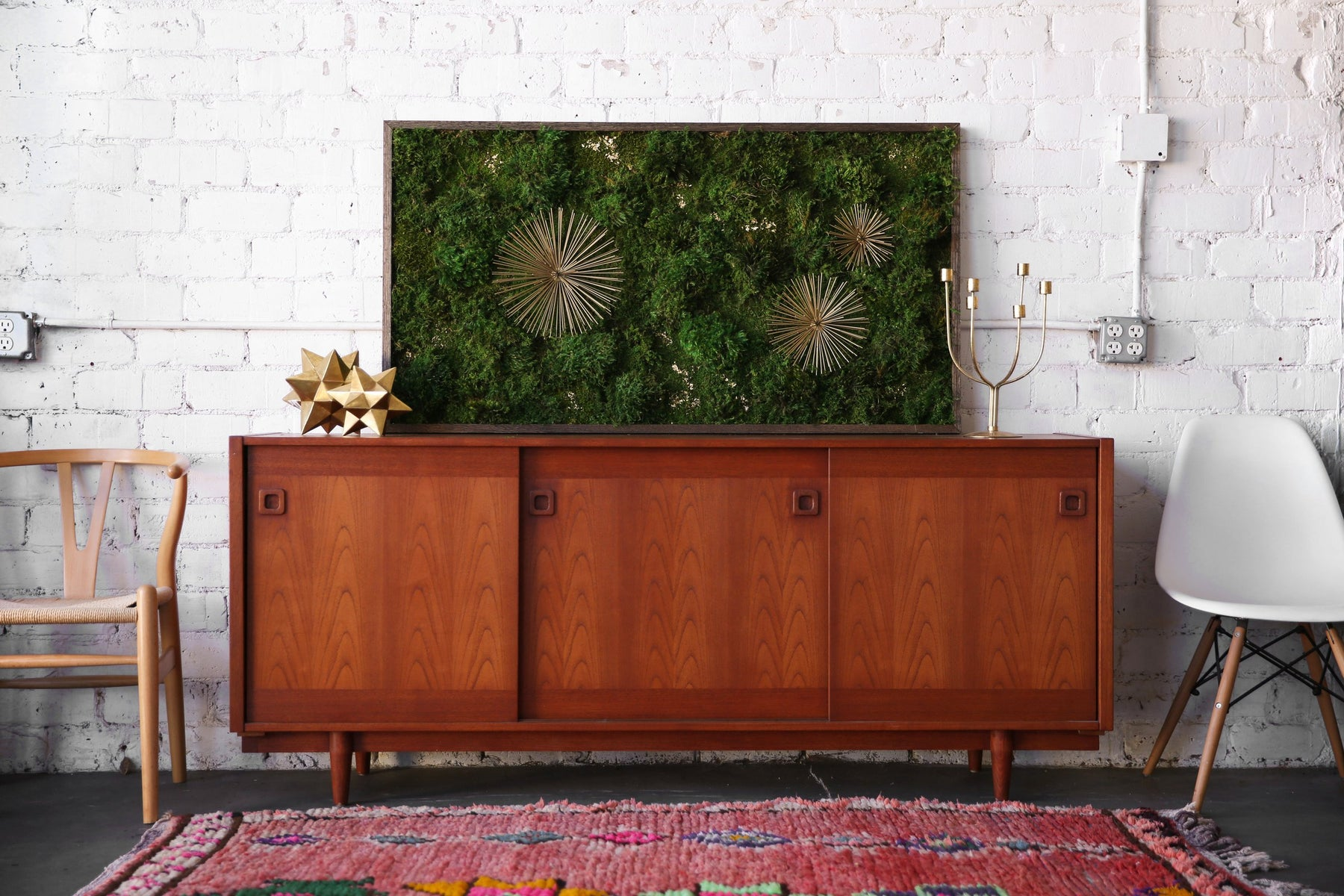 Kelley's starburst moss art on a mid century modern breakfront