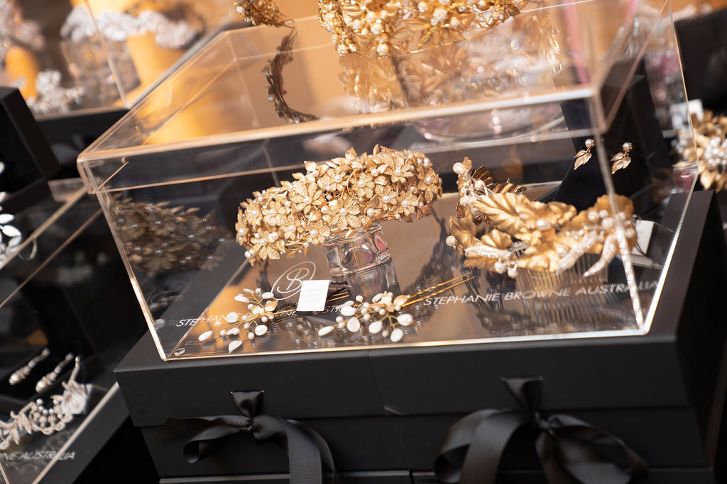 A set of gold plated Bloomingdales, gold plated destiny crown and haruko pins
