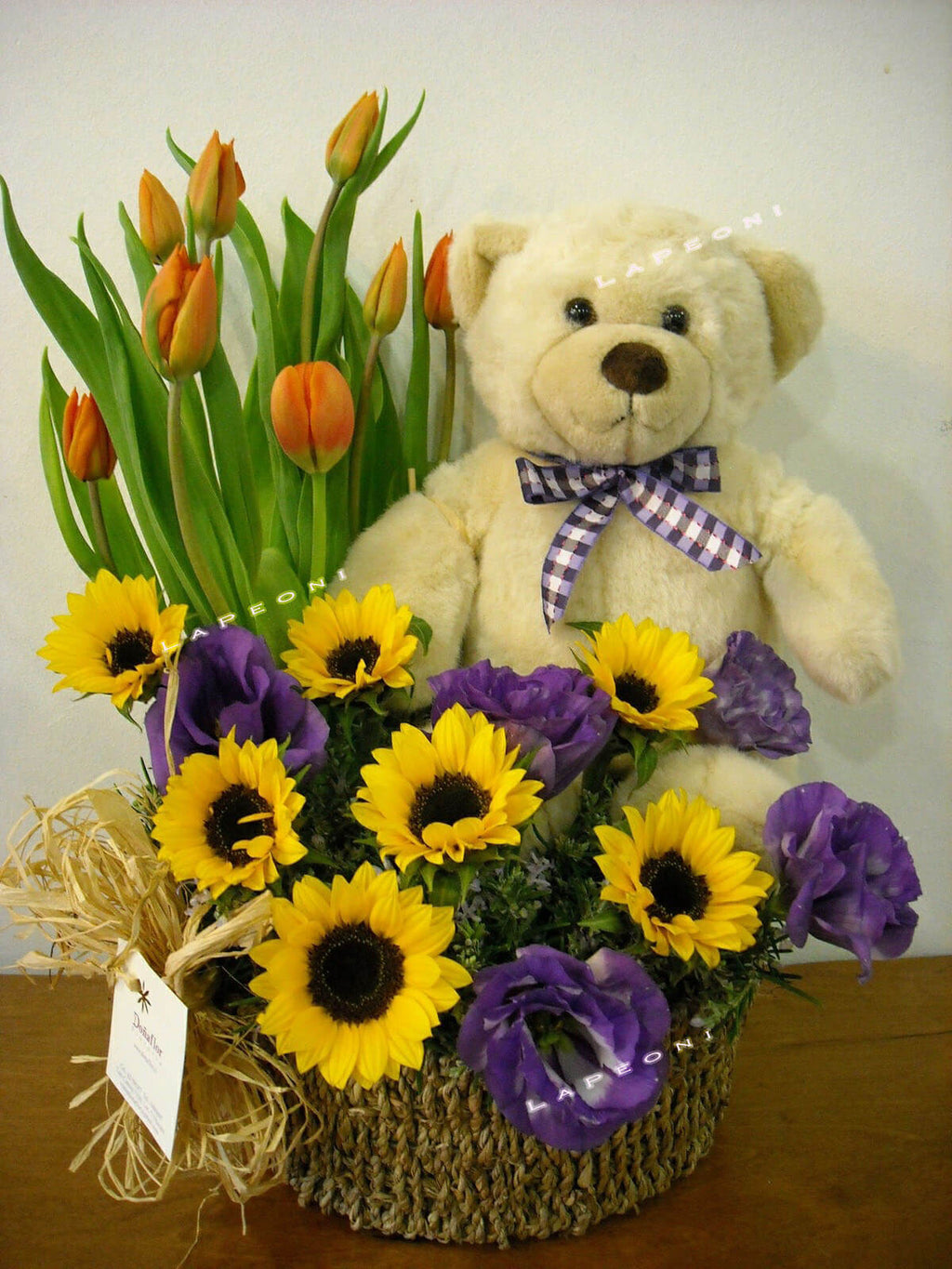 Order flowers for delivery- sunflower, tulip and plush on a basket.