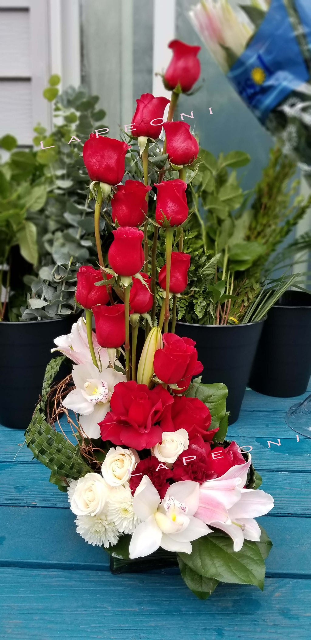 flowers delivery- arranged roses, orchids, lilies