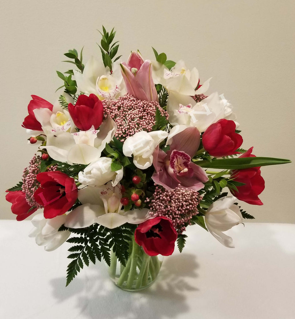 Passion of red tulips, white tulip and other fresh flowers including orchids - Lapeoni Flowers and Events