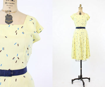 1940s novelty print rayon dress xs | three xxx print buttercup yellow swing dress