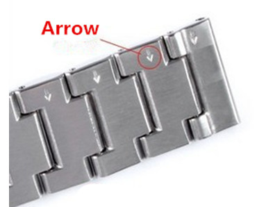 stainless steel watch band with arrow to remove