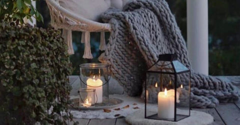 Cosy garden nook with a blanket and lanterns