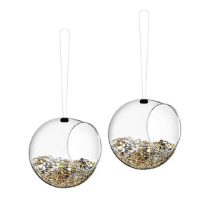 Two Eva Solo mini bird feeders cutout image, showing them filled with bird seed