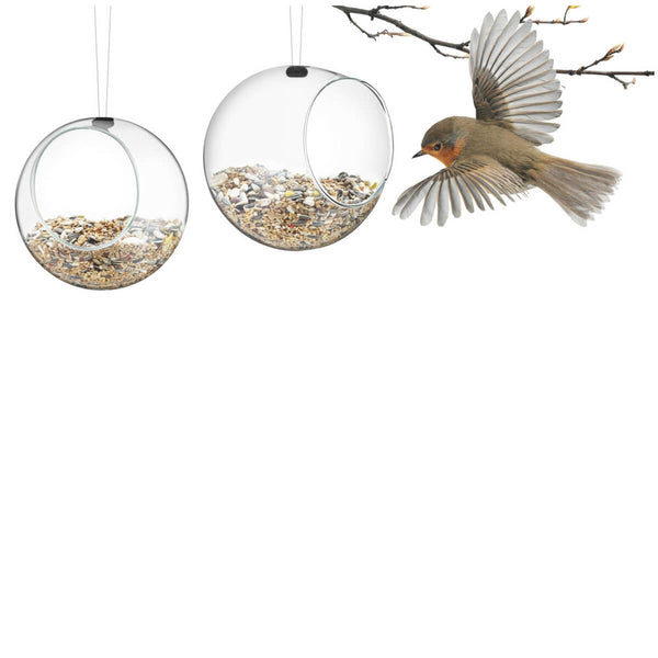 Eva Solo mini bird feeder with bird feed and a flying bird