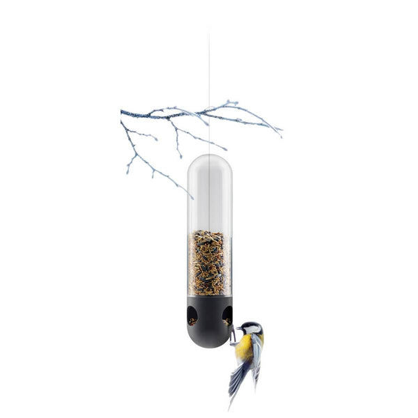 Eva Solo bird feeder tube with a bird feasting on the seed