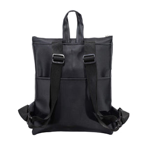 Zendigi's Lucy bags are hand made backpacks from high quality faux leather. urban design 100% vegan. A girl wearing Black Diamond Lucy in Tel Aviv