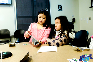Two students tinker with our educational game at Purdue University.