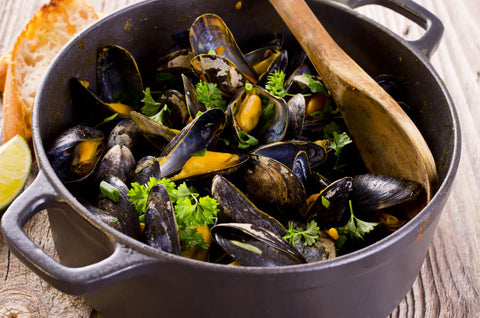 Mussels steaming in a pot