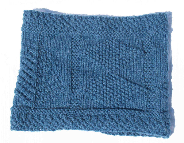 Samantha Cowl knitting kit designed by Deborah Newton and introduced in partnership with the Seamen's Church Institute (SCI) Kit