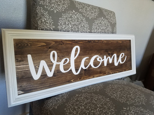 Welcome sign 30x10.  Wood, stain, paint, vinyl, molded frame, mitered corners.