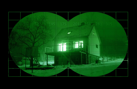 imahe of a house through green night vision filter