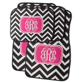 black and pink car mats with initials