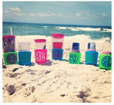 Monogram Beverage Holders Stuck In Sand