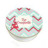 Christmas tree design on chevron pattern cookie tin with name imprinted in center