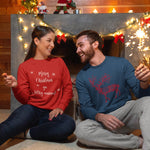 "Beautiful couple wearing christmas outfits anf the women in the left is wearing a red color sweater with this print ""Merry Christmas ya filthy animal""  