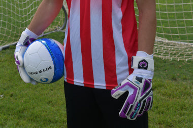 goalkeeper wearing fury uv2 holding the ball with 1 hand