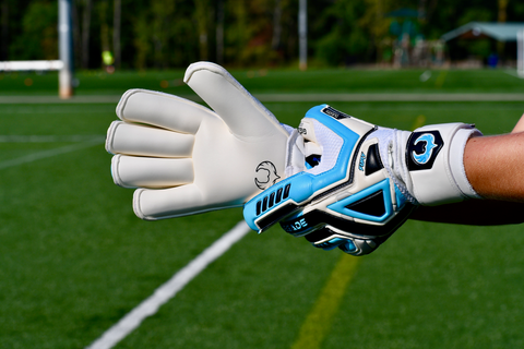 soccer goalkeeper preparing to catch a ball with Fury Sub-Z gloves