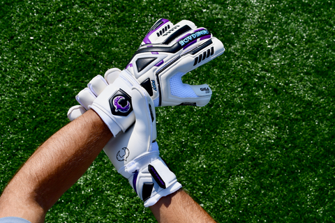 soccer goalie holding the wrist while wearing Renegade GK Fury UV gloves