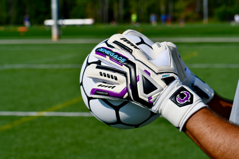goalkeeper wearing Renegade Fury UV holding ball with 2 hands