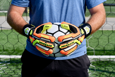 goalkeeper wearing Renegade GK Fury Volt holding the ball  with 2 hands