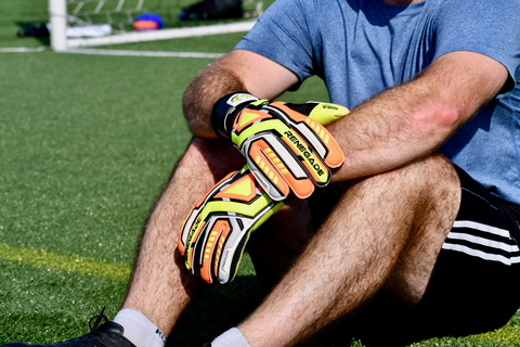 goalkeeper with Renegade GK Fury Volt sitting on the grass