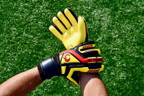goalkeeper checking the straps of talon revolt gloves