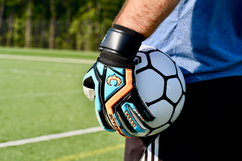 goalkeeper wearing Talon Cyclone 2 holding the ball with 1 hand