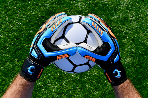 soccer goalie with renegade gk talon cyclone 2 holding ball with 2 hands